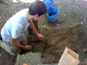 An archeologist excavates the Fort Edward site.