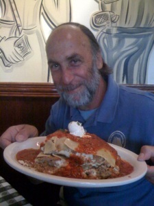 Art Cohn enjoying a large plate of lasagna