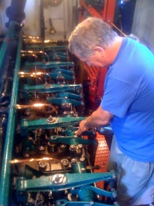 Chris Freeman working on the Atlas engine of the tug Urger