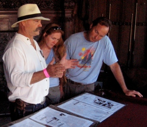 Mark Wright explains about the history of the mansion to Sarah and Erick Tichonuk