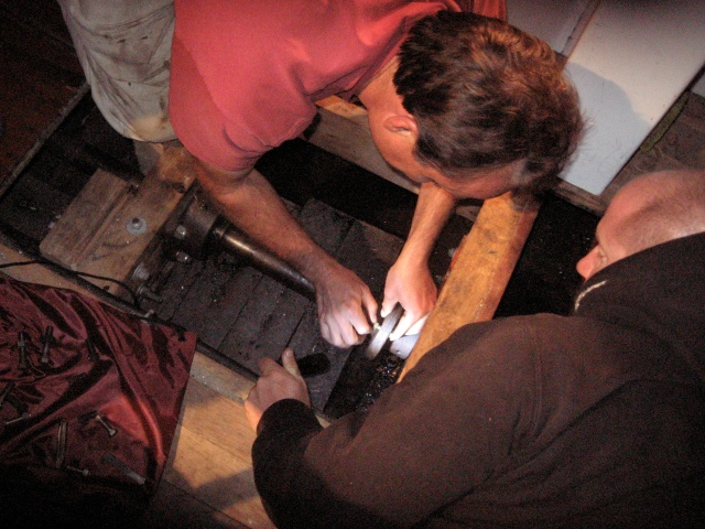 Erick Tichonuk and Andy Scott work on reassembling the driveshaft