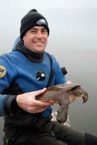 Adam Kane showing a spiny softshell turtle