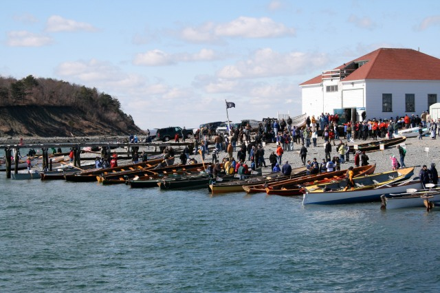 "Rowing boats are lined up on the beach at Windmill Point, Hull, Massachusetts at the 2011 ""Snow Row"""