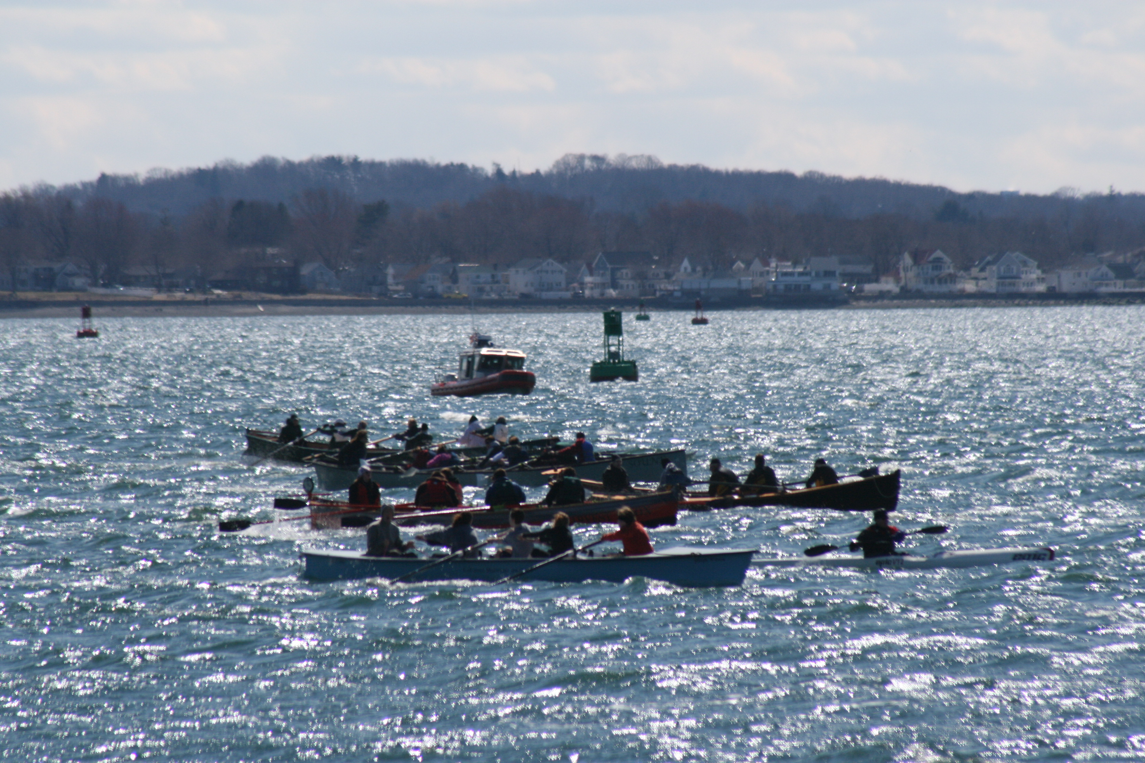 "Vergennes High School (third boat from front) powers to the finish line at the ""Snow Row"" 2011"