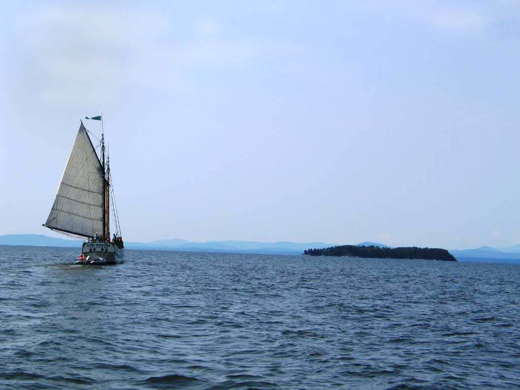 Lois McClure sailing in front of Juniper Island