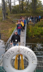 Art leading the exchange students down the dock to the Lois (photo: Tom Larsen)