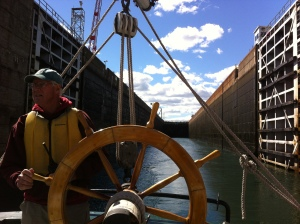 Roger at the helm, leaving Eisenhower Lock (photo: Tom Larsen)