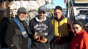 Art, Roger, and Barbara receive the bottle from Scott (photo: Tom Larsen)